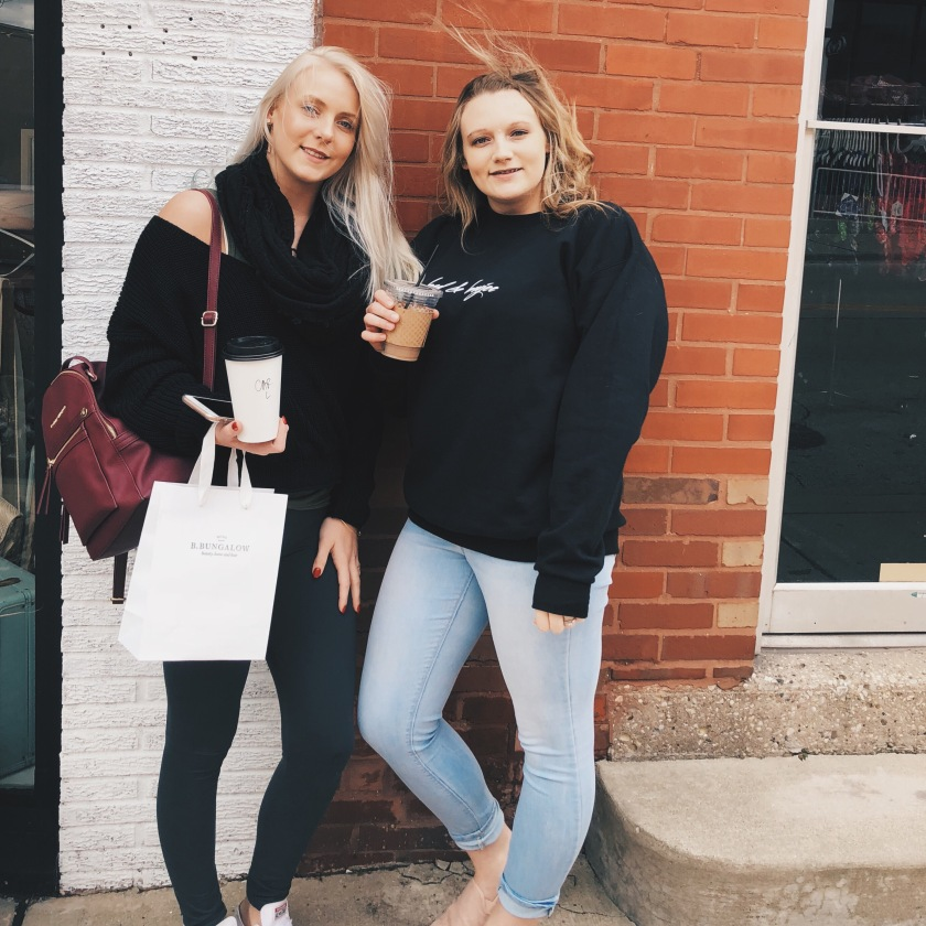 sisters downtown shopping with coffee