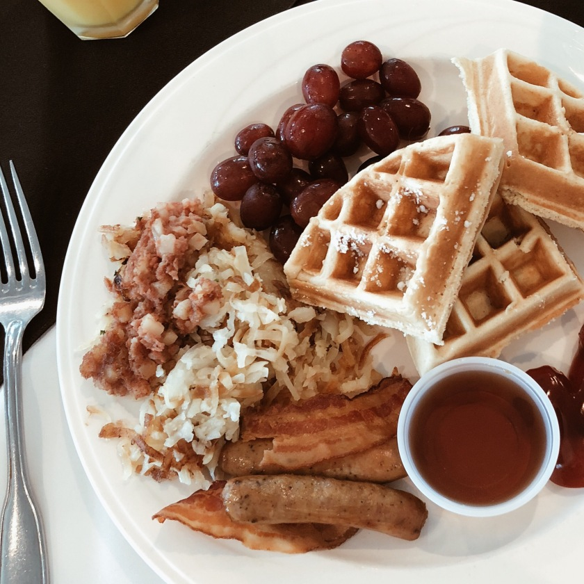Waffles fruit and hashbrowns for breakfast