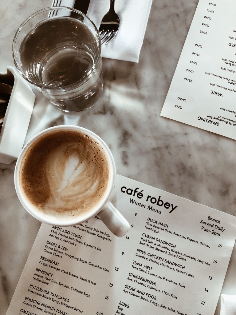 menu at cafe robey in chicago with latte on the side downtown